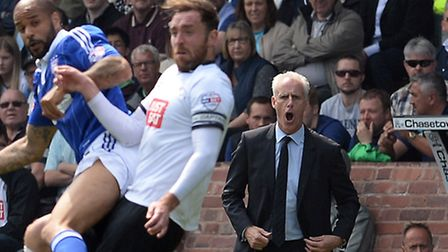 Mick McCarthy urges his players on at Derby