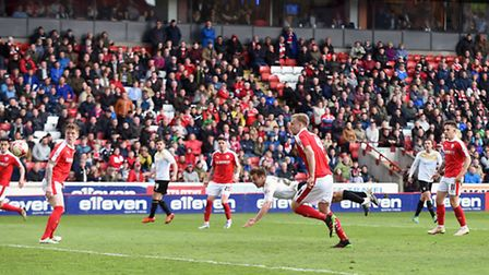 Tom Lapslie's diving injury time header leveled the scores at 2-2 against Barnsley.