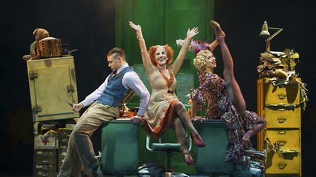 Jonny Fines as Rooster, Lesley Joseph as Miss Hannigan and Djalenga Scott as Lily in Annie. Photo: P