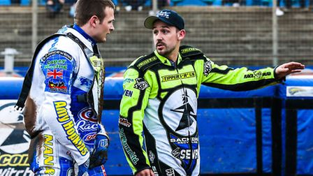 Advice from Skipper Danny King for new boy Oliver Greenwood as they walk back to the pits after the