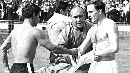 England team manager Alf Ramsey intervening in an exchange of shirts between England defender George