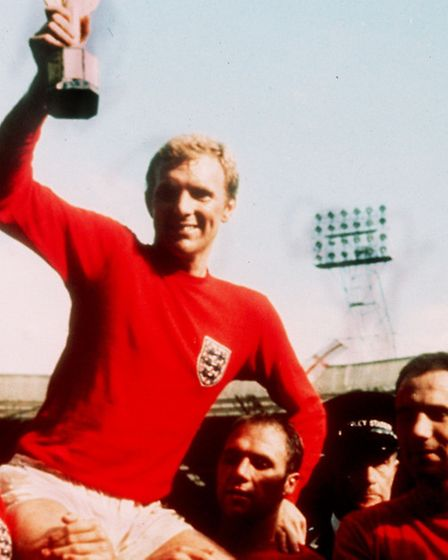 England captain Bobby Moore holds aloft the Jules Rimet trophy. Sir Alf Ramsey led England to World