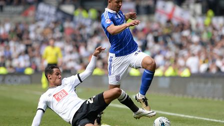 Myles Kenlock is closed down by Derby's Thomas Ince
