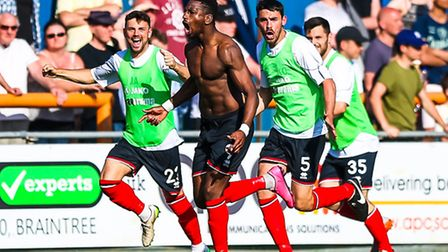 Omar Bogle celebrates his winner for Grimsby in the Braintree v Grimsby (National League Play-off se