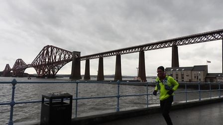 Runner Tom Boother pasing the Forth rail bridge today, Friday April 29, about 8am.