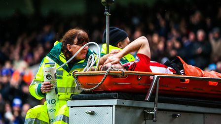 Alan Judge is transported from the pitch by the medical team following his injury in the Ipswich Tow