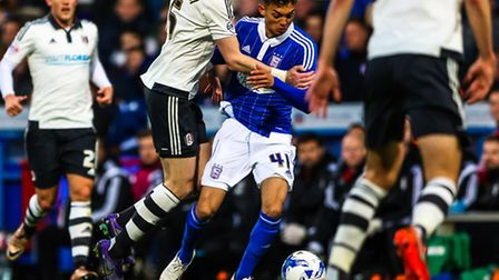 Andre Dozzell battles to get away from Richard Stearman during the Ipswich Town v Fulham (Champions