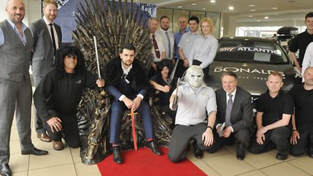 Staff at Donalds Volvo in Ipswich pose with the Iron Throne from Game of Thrones.