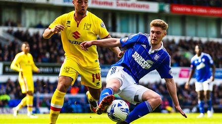 Teddy Bishop on the ball ahead of Samir Carruthers during the Ipswich Town v Milton Keynes Dons (Cha