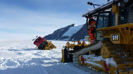 A bulldozer stuck in a crevasse during the Coldest Journey Expedition in 2013, proving it's not all
