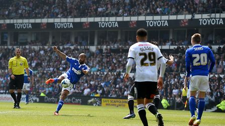David McGoldrick with a volley deflected behind for a corner