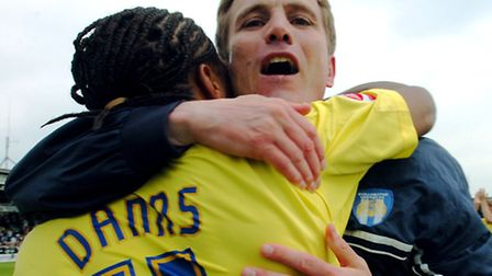 Then U's manager Phil Parkinson celebrates clinching promotion on the final day of the 2005-06 seaso