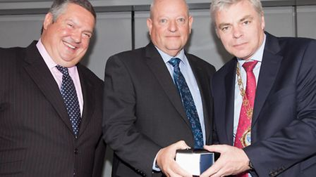 Bernie Aldous (middle) is presented with his award by Robert Fletcher National President (right), an
