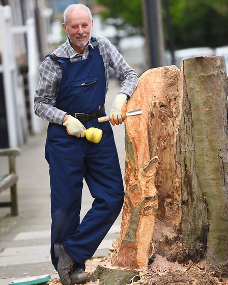 John Williams has decided to carve a tree stump on Eastgate Street in Bury St Edmunds.