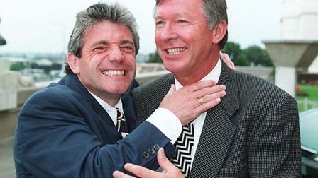 File photo dated 08/06/1996 of Newcastle boss Kevin Keegan (left) getting to grips with Manchester U