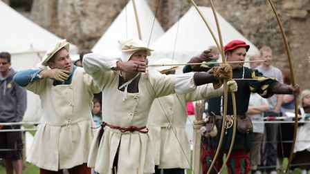 Archers demonstrate their craft during the Bloody Mary event at Framlingham Castle. Photo: Richard M