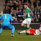 Daryl Murphy (centre) battles for the ball with Switzerland's Timm Klose (right) and goalkeeper Yann