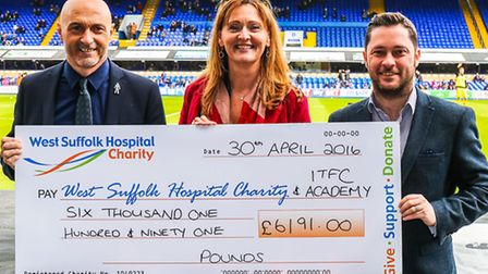 Left to right, Simon Milton, Sue Smith and Dave Gooderham, with the Legends cheque, ahead of the Ips