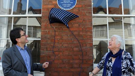 Professor Simon Shorvon and Dr Elizabeth Hall unveil the blue plaque on the front of the Minories in
