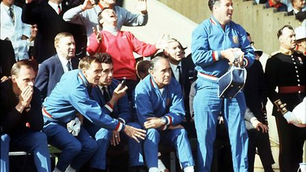Team manager Alf Ramsey and trainer Harold Sheperdson (standing) watch England's victory over German