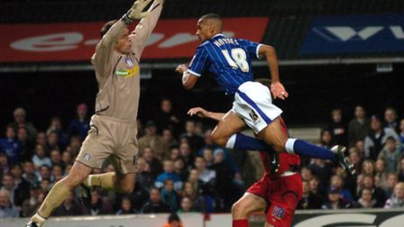 Danny Haynes heads the ball past Colchester goalkeeper Aidan Davison during a 3-1 win in 2007