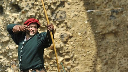 An archer launches his arrow at Framlingham Castle's Bloody Mary living history weekend.