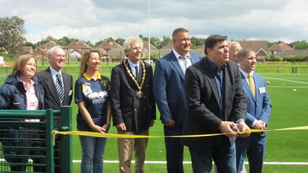Micky Quinn cuts the tape to officially re-open the Ridgeons Stadium at Newmarket Town