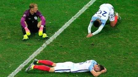 Joe Hart (left) Gary Cahill (bottom) and Dele Alli show their dejection after the final whistle duri