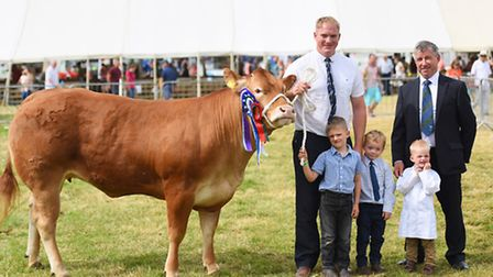 Tendring Show, Lawford House Park, Manningtree. Supreme Beef Cattle Champion winners. Left to right,