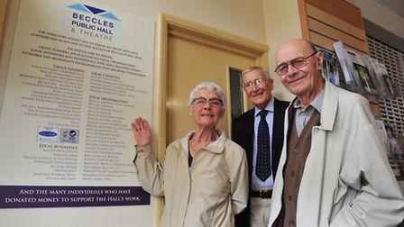 Members of the Adrian Bell society with the new sign that has been placed inside Beccles Public Hall