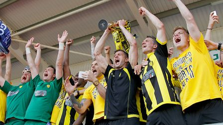 Burton Albion players lift the runners up trophy after they are promoted from the Sky Bet League One