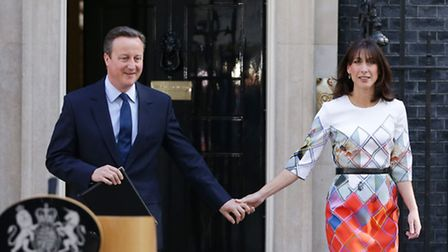 Prime Minister David Cameron walks out of 10 Downing Street, London, with wife Samantha. Photo: Dan