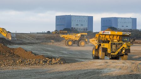 100 tonne dumpers working on the Hinkley Point C site, in front of Hinkley Point B.