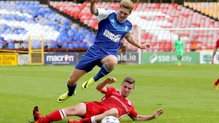 Teddy Bishop leaps a tackle in Ireland during pre-season. He will wear number 7 this season