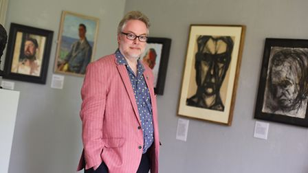 Art expert Andrew Lambirth with his collection portraits that have gone on display at Gainsborough's