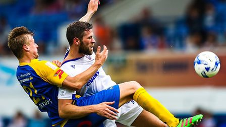 Daryl Murphy is held back by Gertjan Martens during the Ipswich Town v Royale Union Saint-Gilloise (