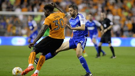 Cole Skuse closes down Kortney Hause at Wolves. Photo: Pagepix