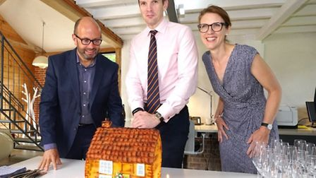 Central Suffolk MP Dan Poulter cuts a cake celebrating 10 years in business for holiday lettings age