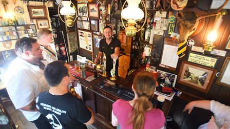Nutshell pub in Bury St Edmunds is now just the second smallest pub in the UK. Pictured is manager J