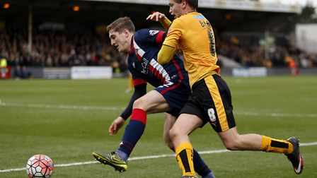Conor Grant, left, in action while on loan at Doncaster last season