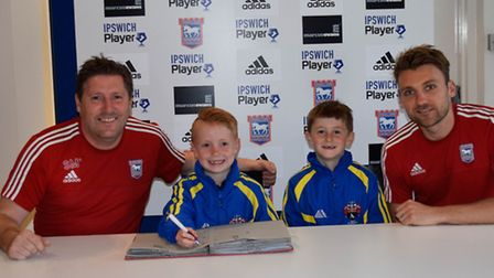 Towns head of academy recruitment Steve McGavin with Under-9s players Kian Chubb and Alex Cooper, w