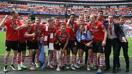 Barnsley players celebrate winning the Sky Bet League One Play-Off Final at Wembley Stadium.