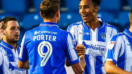 Kurtis Guthrie is congratulated by team-mate Chris Porter after scoring Colchester United's second g