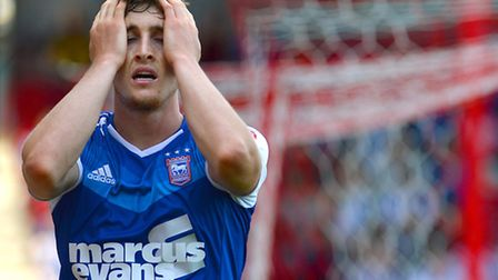 Conor Grant's reaction after being denied by a save from Daniel Bentley at Brentford