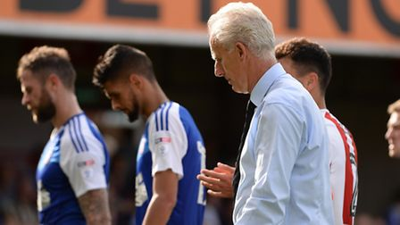 Mick McCarthy leaves the pitch after the loss at Brentford on Saturday