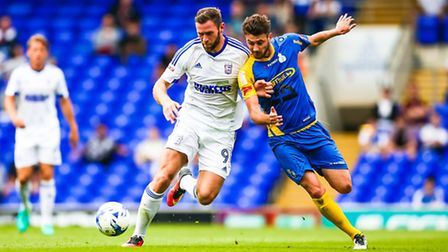 Daryl Murphy goes shoulder to shoulder with Lou Wallaert in this battle for the ball during the Ipsw