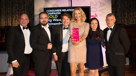 Big Wave PR and Remembrance Travel receiving their gold award at the Anglia, Thames and Chiltern PR