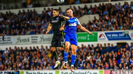 Town's Jonas Knudsen and Brighton's Anthony Knockaert battle for a high ball during the Ipswich Town
