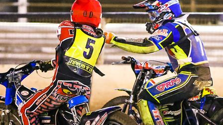 Ben Barker (red helmet) and Danyon Hume congratulate each other on a maximum 5-1 advantage in heat f