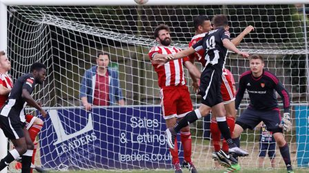 Rhys Barber heads clear for Felixstowe in their FA Cup win over Tilbury on Saturday